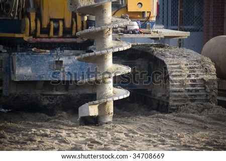 drilling machine on construction site / industrial background - stock photo