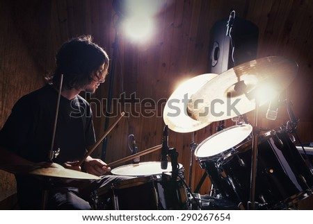 drummer playing his kit - stock photo