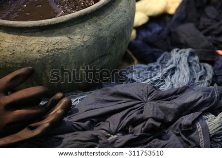 Dyeing Pots with colorful yarns dyed to blue fabric in Chiang Mai, Thailand - stock photo