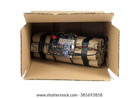 Dynamite with timing device in cardboard box. - stock photo