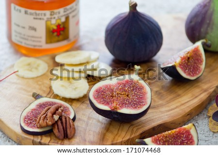 ?ealthy breakfast with fruits, nuts, and honey - stock photo