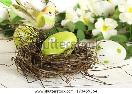 Easter decoration: bird and egg in a nest