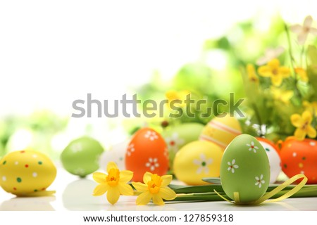 Easter eggs decorated with flowers on white background - stock photo