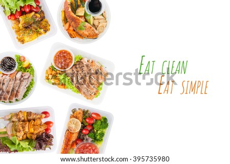 """""""Eat clean Eat simple"""" is written on white background with modern style cuisine cooked by clean food concept including European, Japanese, Thai, and Chinese food style in lunch box - stock photo"""