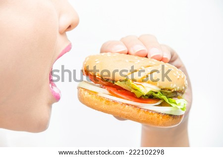 eating a hamburger. isolated on a white background