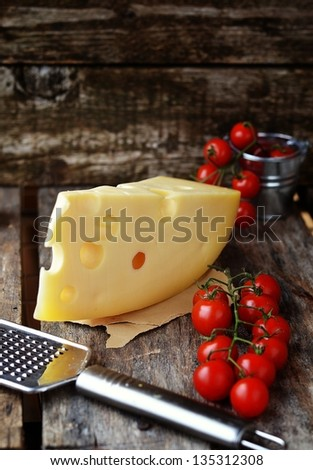 Edam cheese on the wooden table - stock photo