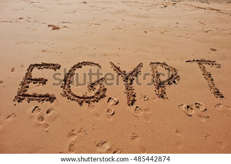 """Egypt"" written in the sand on the beach"