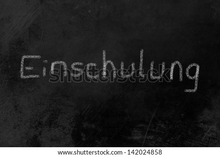 """Einschulung (German: my first day at school) written on a blackboard"
