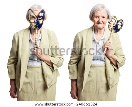 Elderly woman with carnival mask standing over white
