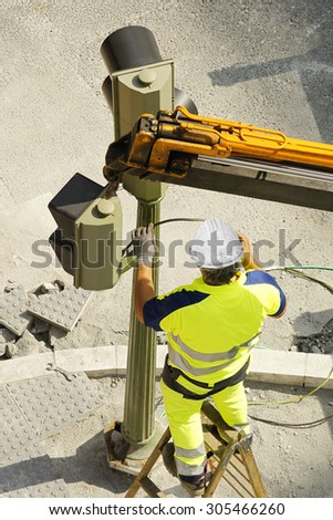 electrician utility service worker  company to repair traffic lights in the street city - stock photo