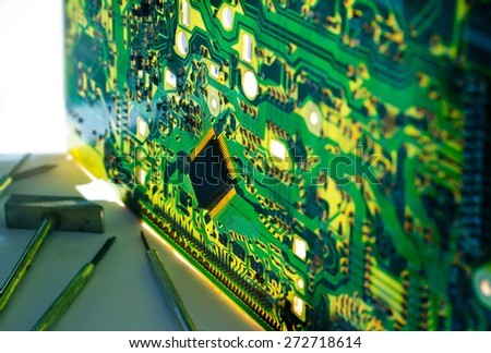 Electronic circuit transparent and tools repair  - stock photo