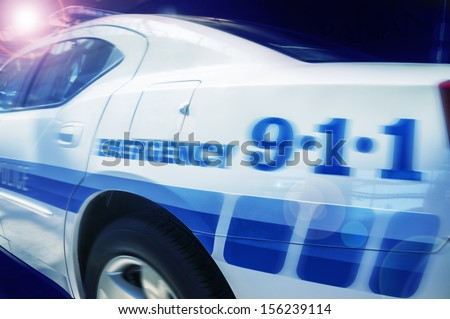 911 Emergency response police car speeding to scene of crime - stock photo