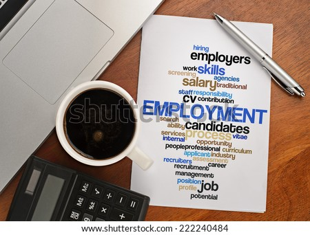 """EMPLOYMENT word cloud arrangement"" Notebook with text vision on table with coffee, calculator and notebook - stock photo"