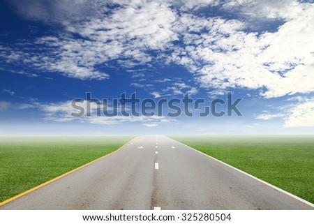 empty asphalt road on green grass and sky - stock photo