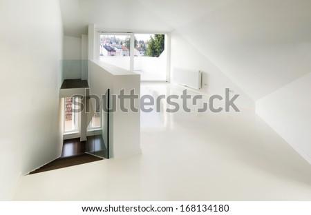 empty attic room with white epoxy flooring - stock photo