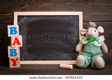 empty chalk board on  wooden background - stock photo