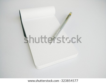 Empty Notepad and Mechanical Pencil on White Background