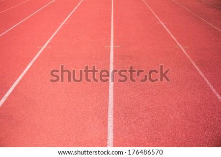 empty stadium arena and race running track treadmill background - stock photo