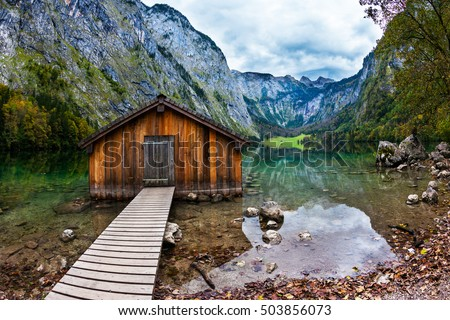 Enchanted Lake Obersee in the Bavarian Alps. Boat garage in the middle of the lake. The concept of active tourism and ecotourism