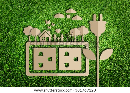 Energy saving concept. Paper cut of eco on green grass - stock photo
