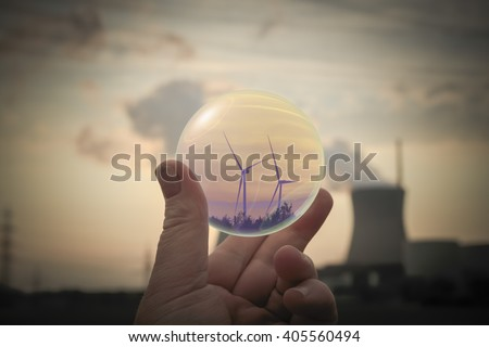 Energy transition from nuclear power to environmentally friendly technology - stock photo