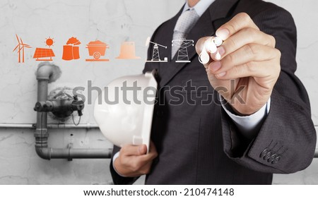 engineer shows oil and gas refinery, pipelines and towers, heavy industry as concept - stock photo