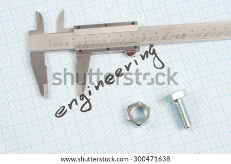 """""""engineering"""" - Screw and  Nuts on  graph paper background - stock photo"""