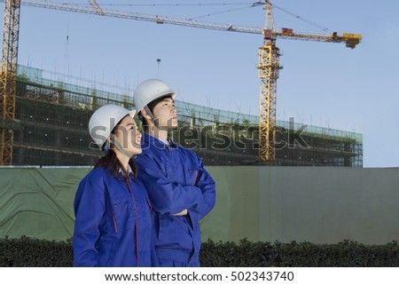 Engineers working at construction field
