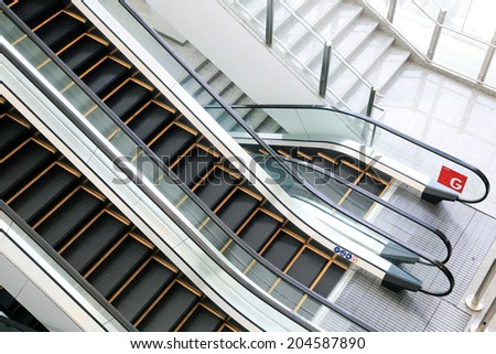 Escalator stairs in station. - stock photo
