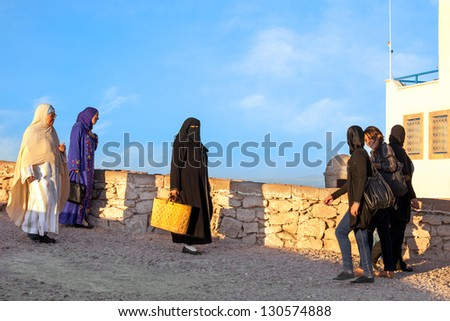 ESSAOUIRA, MOROCCO-DEC.22: Moroccan women wearing a variety of clothing from traditional robes to jeans in the seaport town of Essaouira, Morocco on Dec. 22, 2012. Morocco has no Islamic dress code for women. - stock photo