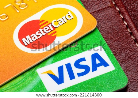 Estonia - September 24, 2014. Visa and Mastercard credit cards with the leather wallet on the background. Mastercard and Visa are the biggest credit card companies in the world. - stock photo