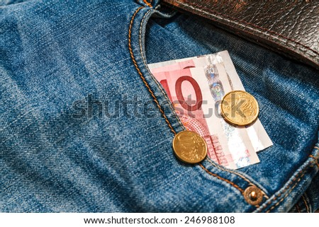 10 euro and coins in your pocket jeans. Business concept. The economic concept - stock photo
