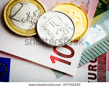 euro and ruble coins on euro banknotes - stock photo