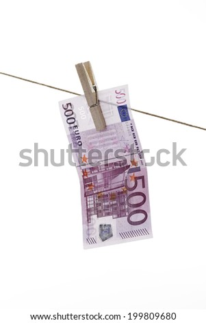 500 Euro bank note hanging on clothesline