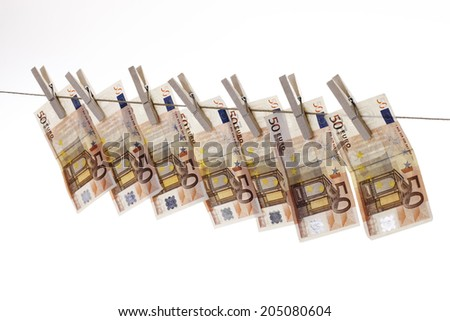 50 Euro bank notes hanging on clothesline - stock photo
