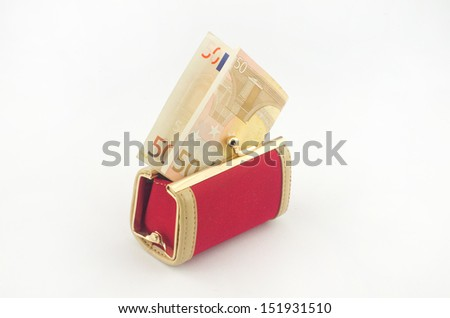 50 euro banknote sticking out of the small red wallet - stock photo