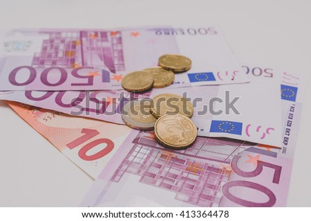 500 Euro banknotes and coins, isolated on white - stock photo