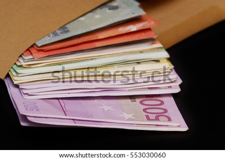 Euro banknotes in a large envelope