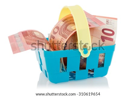 Euro banknotes in shopping basket,isolated on white background. European Union currency - stock photo