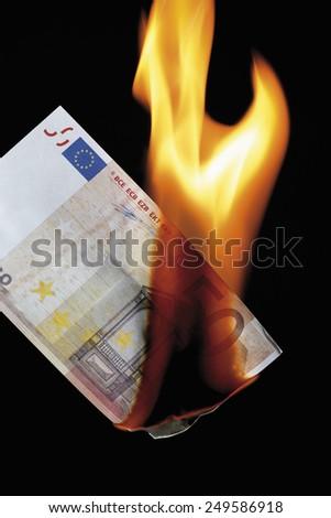 50 euro note burning against black background - stock photo