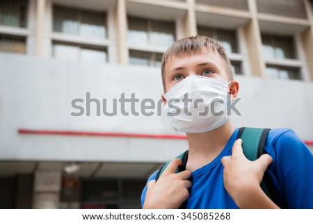 European boy in a protective mask in Beijing, China - stock photo