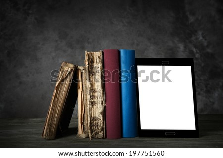 """Evolution of reading"" - concept - old yellowed books, new books and an self-designed  e-reader with blank display (for your text) in a bookshelf - stock photo"