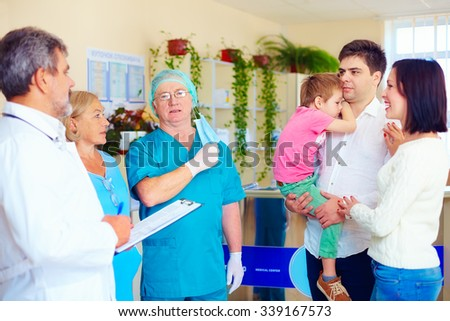 exhausted medical staff announcing good news to relatives after long and difficult surgery