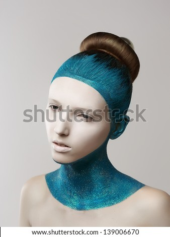 Expression. Fantasy. Eccentric Woman with Blue Painted Skin and Hair. Coloring - stock photo