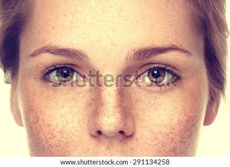 Eyes Woman freckle happy young beautiful studio portrait with healthy skin - stock photo