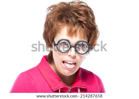 Face expressions and people concept - portrait of teenage girl in funny glasses