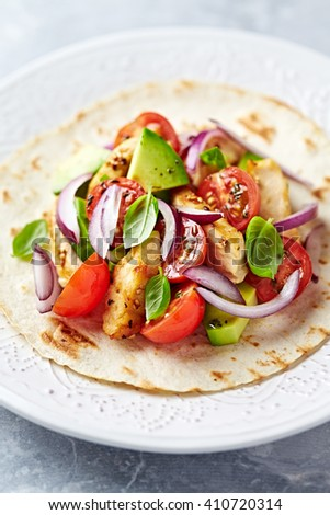 Fajita with grilled Sesame Chicken, fresh Tomatoes and Avocado - stock photo