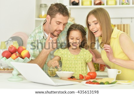 family and daughter with food - stock photo