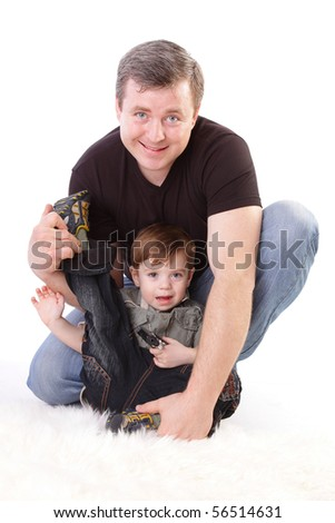 Family: father and son. Middle-aged man playing with little boy isolated on white.