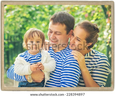 family father playing with baby on nature vintage card